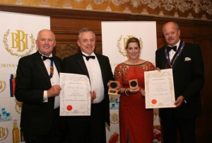 Padraig McEneaney and Claire Braiden of Celtic Pure receiving their awards for 'Irish Spring Water - Still' (Gold for Spring Water - Still) and 'Irish Spring Water - Sparkling' (Silver for Spring Water - Sparkling) from Wyllie Woodburn, BBI Chairman (extreme left) and Ed Binsted, BBI President (extreme right).