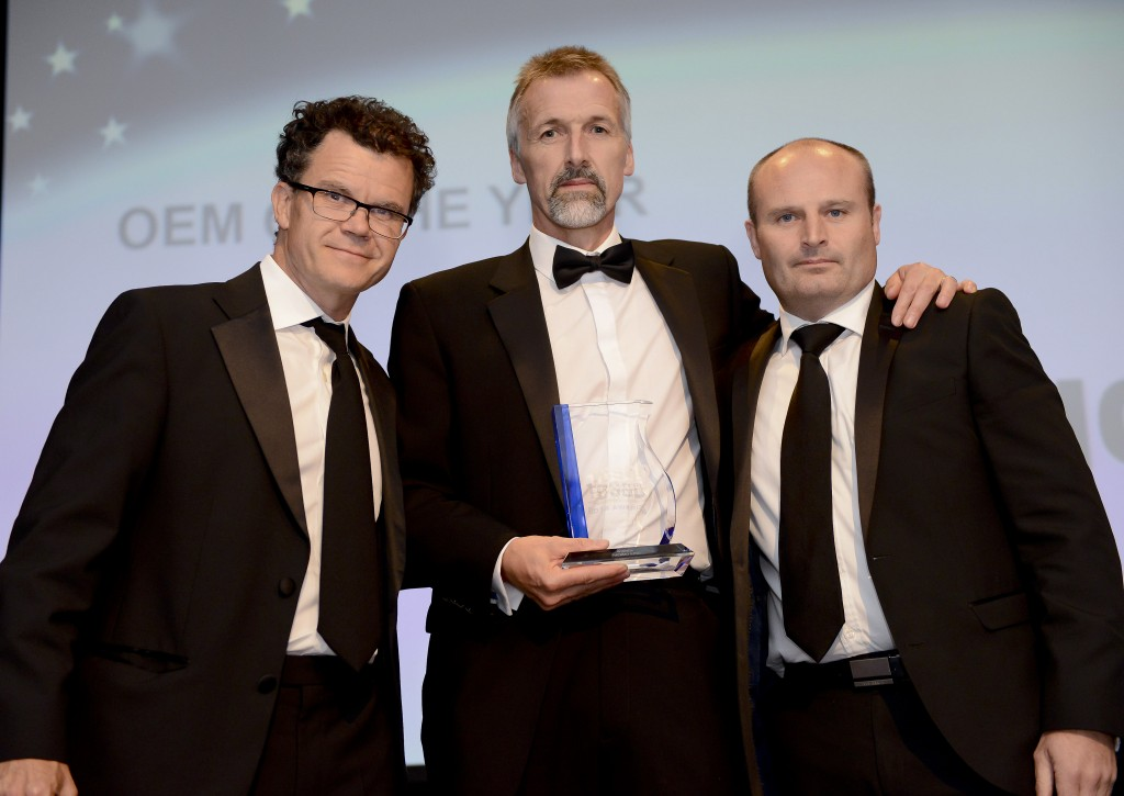 Standing from left are: Dominic Holland, master of ceremonies at the TCS&D Awards;  Stephen Williams, Thermo King and Arran Leatherland of IMS Ltd who presented the award.